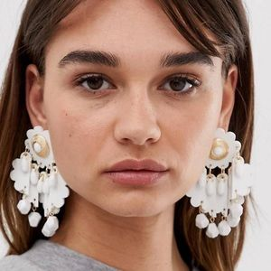 ASOS earrings in faux leather w/ bead shimmy